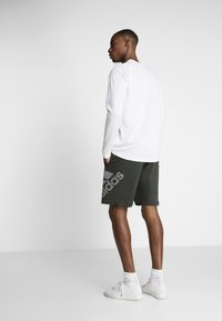 adidas Performance - Sports shorts - green - 2