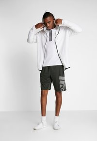 adidas Performance - Sports shorts - green - 1