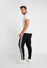 adidas Performance - TIRO19 FT PNT - Spodnie treningowe - black/white - 2