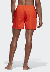 adidas Performance - SOLID SWIM SHORTS - Swimming shorts - orange - 1