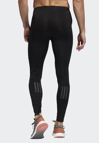 adidas Performance - OWN THE RUN LONG TIGHTS - Tracksuit bottoms - black - 1