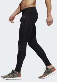 adidas Performance - OWN THE RUN LONG TIGHTS - Tracksuit bottoms - black - 2