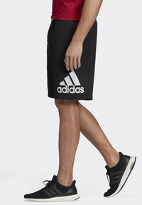 adidas Performance - MUST HAVES BADGE OF SPORT SHORTS - Sports shorts - black - 3