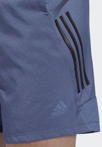 adidas Performance - 4KRFT TECH WOVEN 3-STRIPES SHORTS - Urheilushortsit - blue - 4