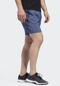 adidas Performance - 4KRFT TECH WOVEN 3-STRIPES SHORTS - Urheilushortsit - blue - 3