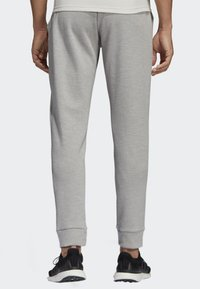 adidas Performance - ID STADIUM TRACKSUIT BOTTOMS - Tracksuit bottoms - grey - 1