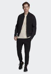 adidas Performance - VRCT PRIMEKNIT JOGGERS - Verryttelyhousut - black - 1