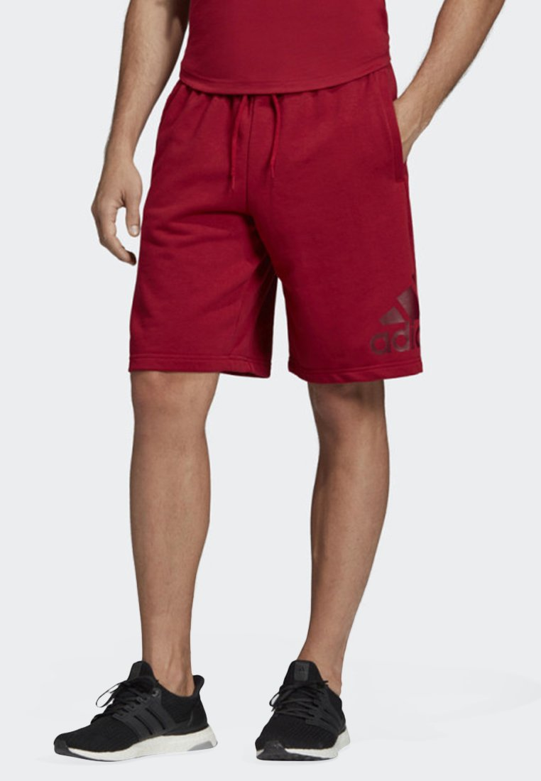 adidas Performance - MUST HAVES BADGE OF SPORT SHORTS - Shorts - red
