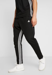 adidas Performance - Tracksuit bottoms - black/white - 0
