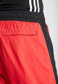 adidas Performance - SHAPE PANT - Spodnie treningowe - scarlet - 5