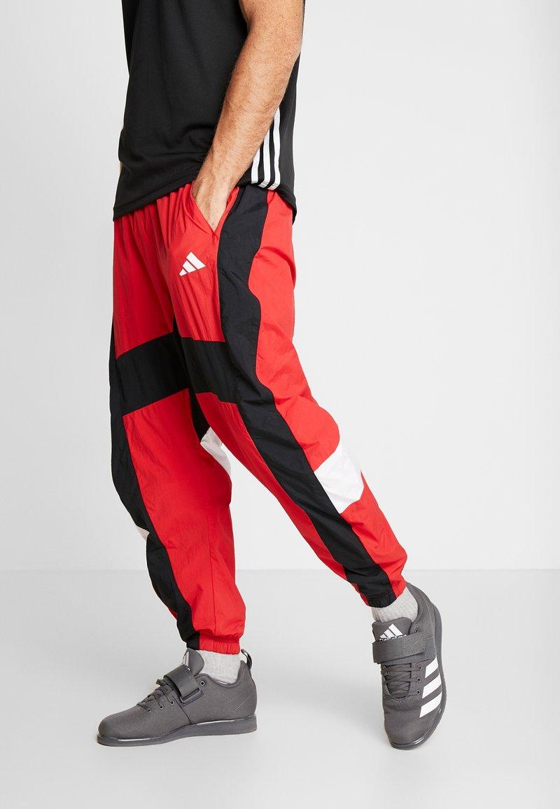 adidas Performance - SHAPE PANT - Pantalon de survêtement - scarlet
