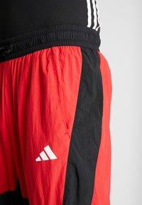 adidas Performance - SHAPE PANT - Spodnie treningowe - scarlet - 3
