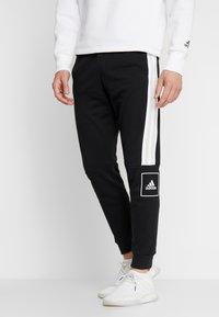 adidas Performance - SLIM PANT - Spodnie treningowe - black - 0