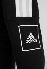 adidas Performance - SLIM PANT - Spodnie treningowe - black - 5