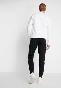 adidas Performance - SLIM PANT - Spodnie treningowe - black - 2
