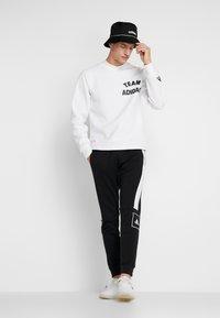 adidas Performance - SLIM PANT - Spodnie treningowe - black - 1
