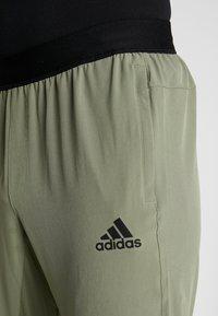 adidas Performance - CITY BASE DESIGNED4TRAINING SPORT PANTS - Pantalones deportivos - green - 3