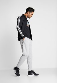 adidas Performance - MUST HAVE AEROREADY ATHLETICS SPORT PANTS - Pantalones deportivos - grey - 1