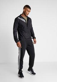 adidas Performance - OWN THE RUN - Chaqueta de deporte - black - 1