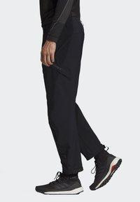 adidas Performance - TERREX HIKE TROUSERS - Trousers - black - 3