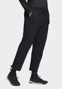 adidas Performance - TERREX HIKE TROUSERS - Trousers - black - 4
