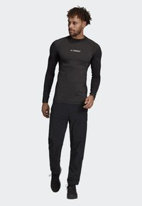 adidas Performance - TERREX HIKE TROUSERS - Trousers - black - 1