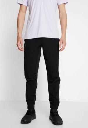 TENNIS PANT - Teplákové kalhoty - black