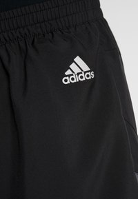 adidas Performance - OWN THE RUN - Sports shorts - black/greone/gresix - 7