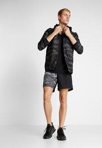 adidas Performance - OWN THE RUN - Sports shorts - black/greone/gresix - 1