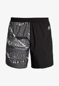 adidas Performance - OWN THE RUN - Sports shorts - black/greone/gresix - 6