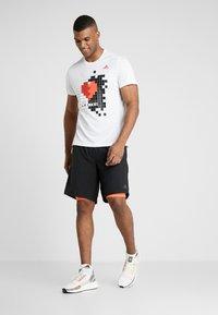 adidas Performance - OWN THE RUN 2N1 - Pantalón corto de deporte - black/solred - 1