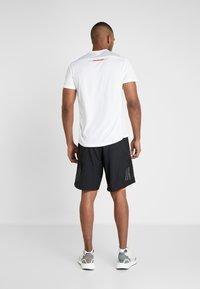 adidas Performance - OWN THE RUN 2N1 - Pantalón corto de deporte - black/solred - 2