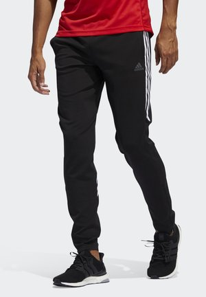 RUN IT 3-STRIPES ASTRO JOGGERS - Tracksuit bottoms - black