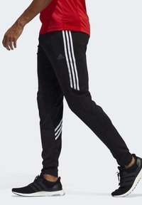 adidas Performance - RUN IT 3-STRIPES ASTRO JOGGERS - Tracksuit bottoms - black