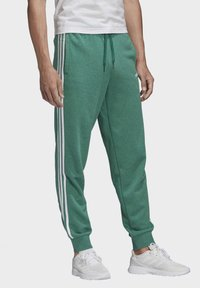 adidas Performance - ESSENTIALS 3-STRIPES TAPERED CUFFED JOGGERS - Tracksuit bottoms - green - 2