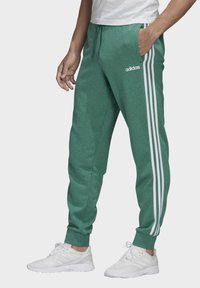 adidas Performance - ESSENTIALS 3-STRIPES TAPERED CUFFED JOGGERS - Tracksuit bottoms - green - 3