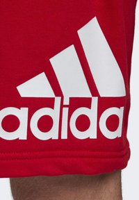 adidas Performance - MUST HAVES BADGE OF SPORT SHORTS - Sports shorts - red - 5