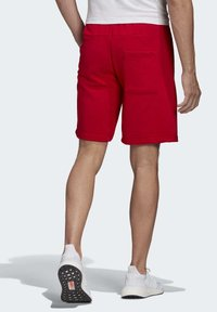 adidas Performance - MUST HAVES BADGE OF SPORT SHORTS - Sports shorts - red - 1