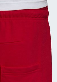 adidas Performance - MUST HAVES BADGE OF SPORT SHORTS - Sports shorts - red - 6