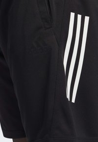 adidas Performance - STRIPES 9-INCH SHORTS - Träningsshorts - black - 6