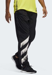 adidas Performance - DECODE JOGGERS - Tracksuit bottoms - black - 2