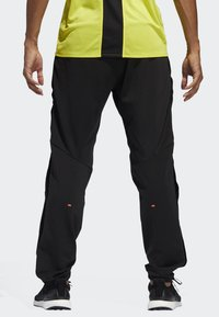 adidas Performance - DECODE JOGGERS - Tracksuit bottoms - black