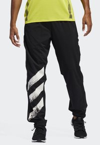 adidas Performance - DECODE JOGGERS - Tracksuit bottoms - black - 0