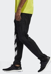adidas Performance - DECODE JOGGERS - Tracksuit bottoms - black - 3