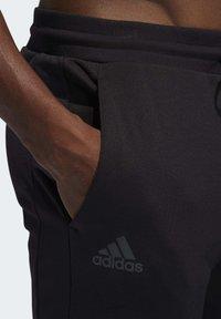 adidas Performance - HARDEN TRACKSUIT BOTTOMS - Jogginghose - black - 4