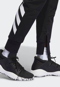 adidas Performance - HARDEN TRACKSUIT BOTTOMS - Jogginghose - black - 5