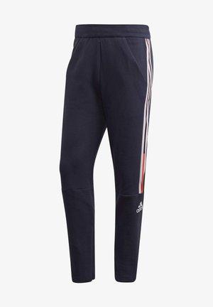 ADIDAS Z.N.E. JOGGERS - Pantalones deportivos - blue