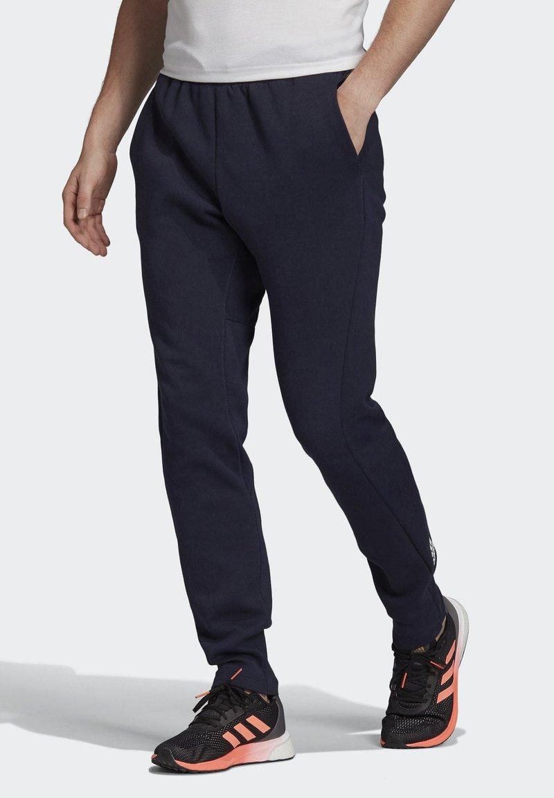 adidas Performance - VRCT TRACKSUIT BOTTOMS - Spodnie treningowe - blue