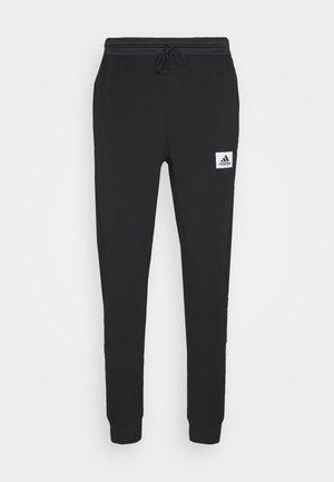 AEROREADY TRAINING SPORTS PANTS - Teplákové kalhoty - black/white