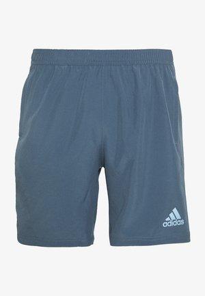 OWN THE RUN - Sports shorts - blue